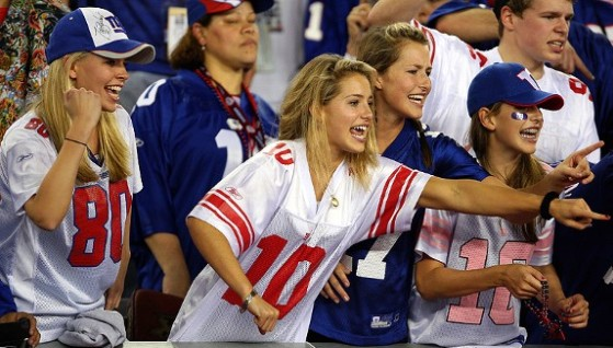 women cheering at football game